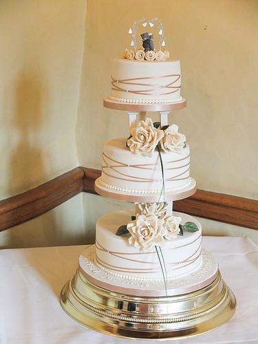 Gold Ivory Cake With Pillars