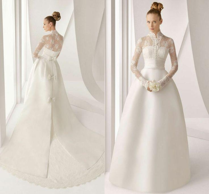 Wedding - Floor length white colored gown with the beautiful bun.