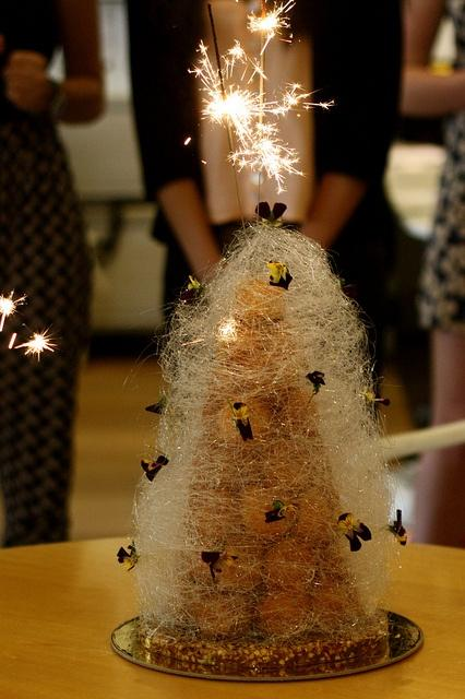Wedding - Croquembouche coated with Sugar Syrup and the cracker on the top.